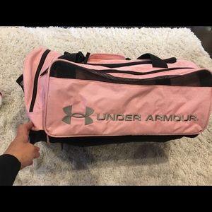 Handbags - Under Armour pink & black large duffel bag. EUC